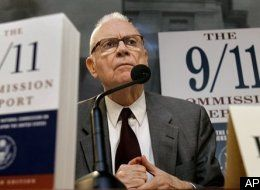 Photo of 9/11 Commissioner Lee Hamilton in front of enlarge copies of the 9/11 Commission Report